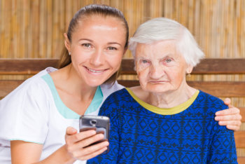 Photo of elderly women with her caregiver